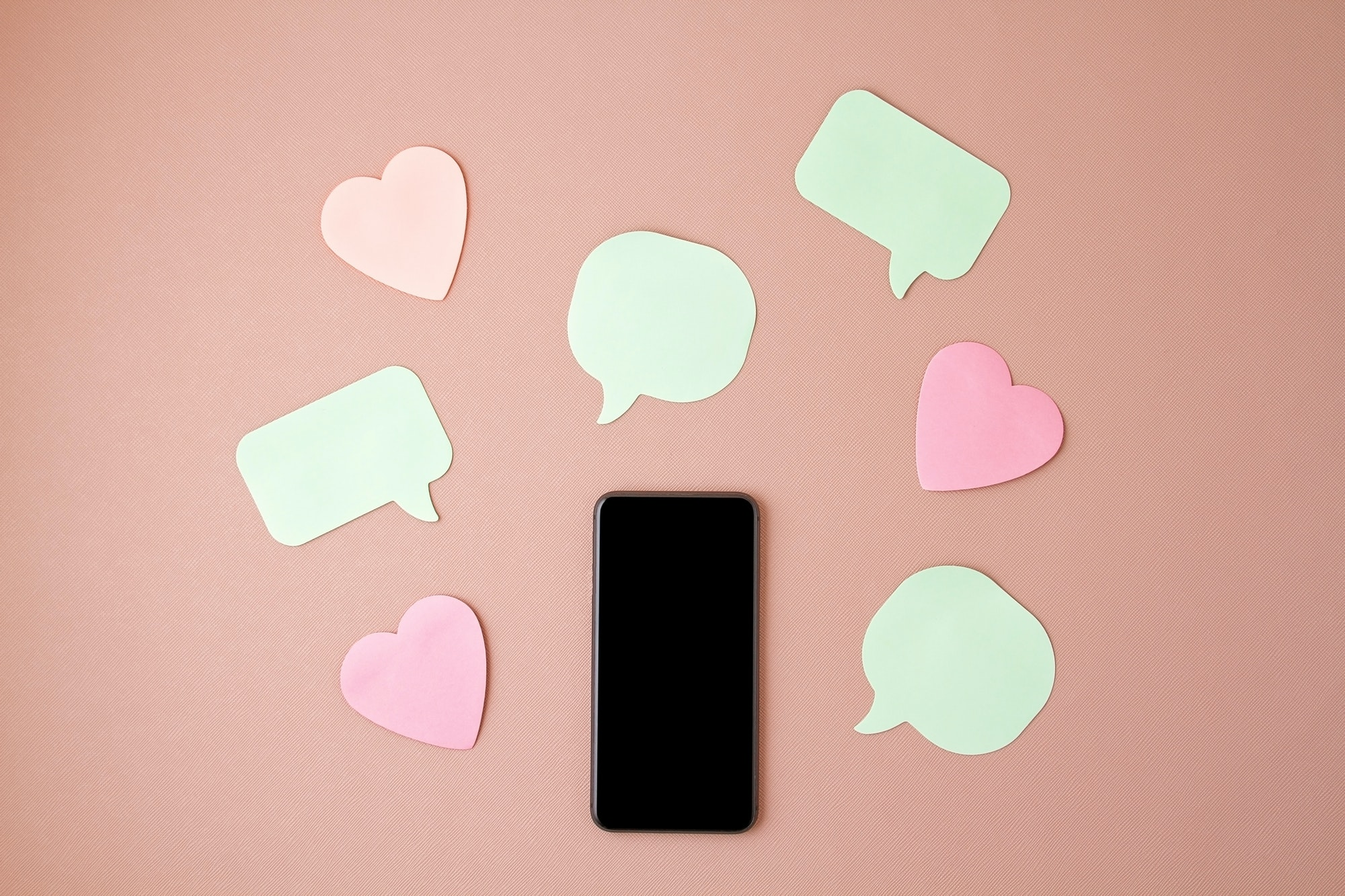 Mockup flat lay with smartphone and hearts and speach bubbles